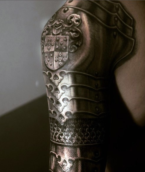 Breathtaking very realistic looking detailed medieval armor tattoo on sleeve area