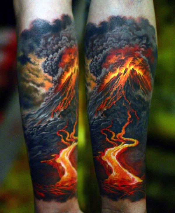 Breathtakingly realistic naturally colored volcano eruption forearm tattoo in realism style
