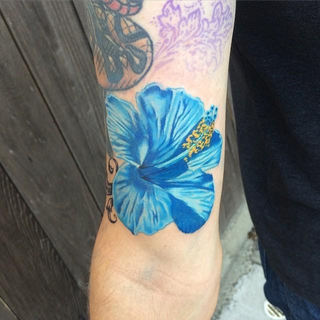 Brilliant bright blue Hibiscus realistic flower detailed lifelike biceps tattoo
