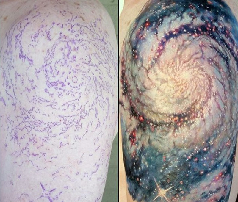 Brilliant colored realistic space tattoo on half sleeve zone