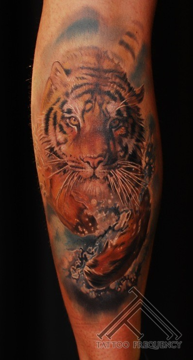 Brilliant designed and painted colored running tiger tattoo on leg