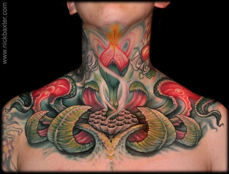 Brilliant designed multicolored chest tattoo if mysterious flower