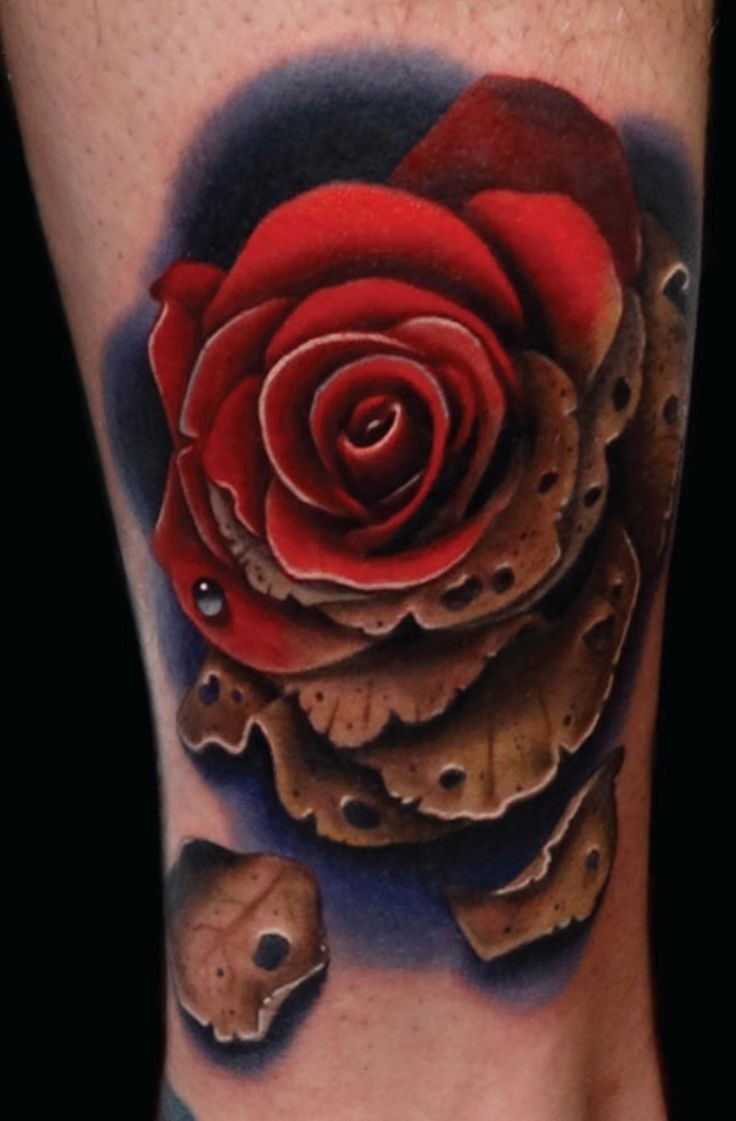 Brilliant detailed and colored little rose tattoo on ankle