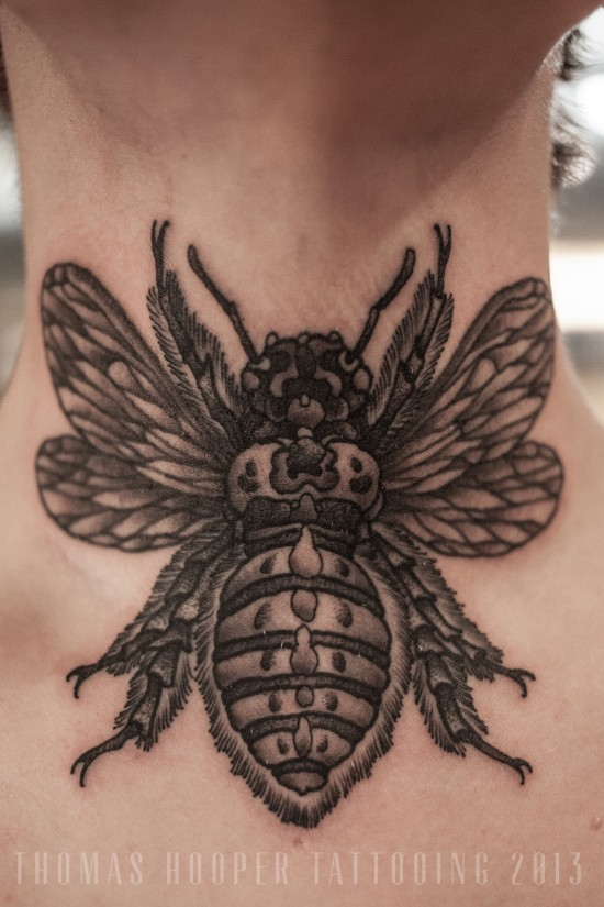 Brilliant painted big black and white detailed insect tattoo on neck