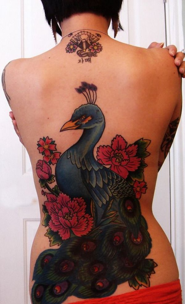 Brilliant painted colored illustrative style black tattoo of beautiful peacock and flowers