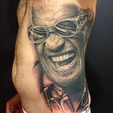 Brilliant very detailed colored famous singer tattoo on side