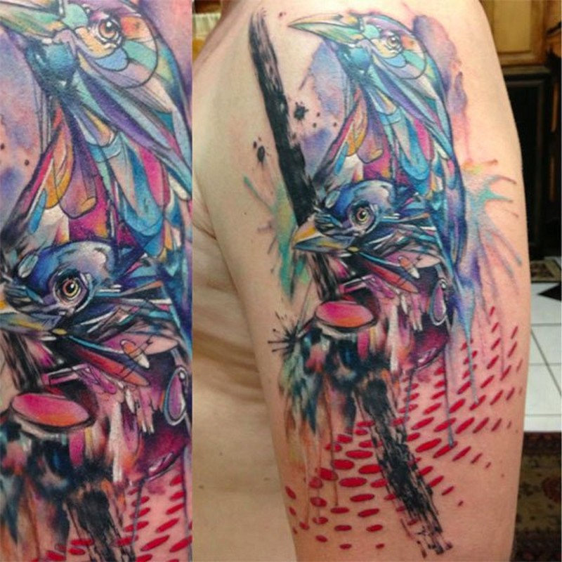 Brilliant watercolor style painted and colored birds upper arm tattoo