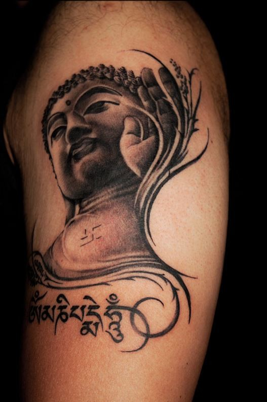 Buddha and buddhist symbolism tattoo on shoulder