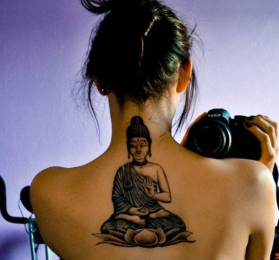 Buddha sitting on a lotus flower tattoo on back for girls