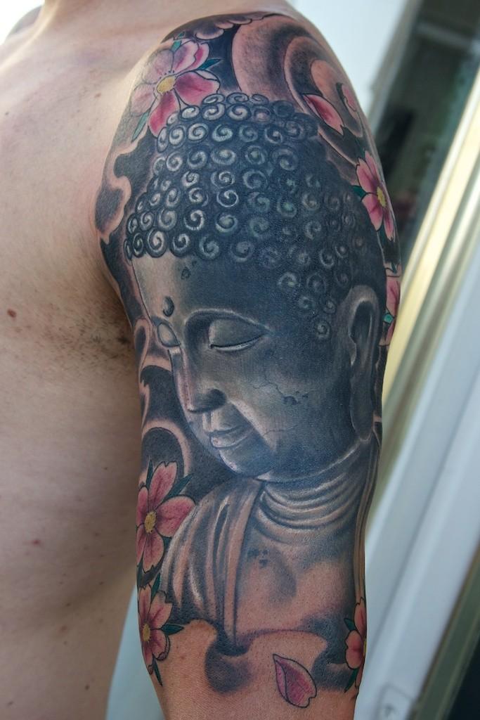 Buddha tattoo on half sleeve project by graynd