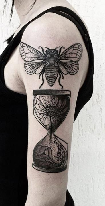 Bug and hourglass black ink tattoo on half sleeve
