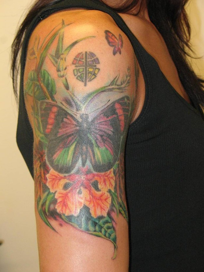 Butterfly and tropical flowers sleeve tattoo
