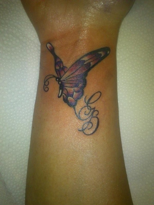 Butterfly wrist tattoos with lettering
