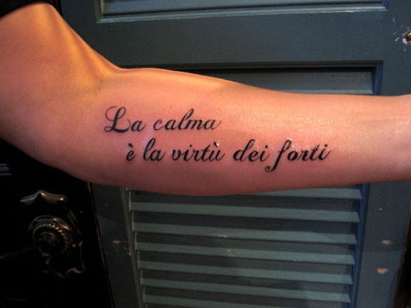 Calm strength in italian forearm tattoo