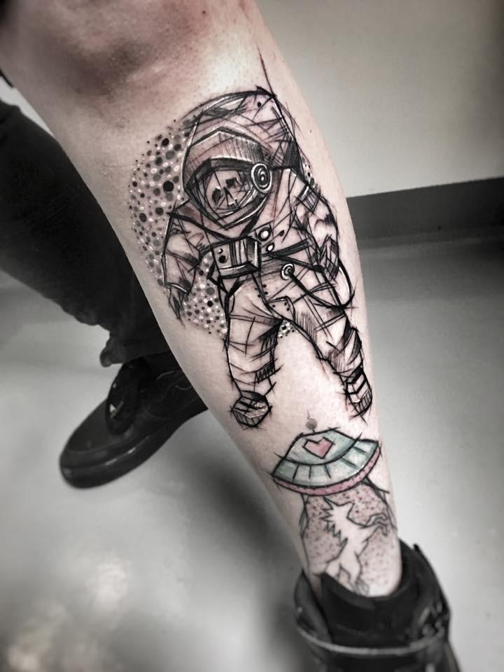 Carelessly painted by Inez Janiak leg tattoo of astronaut skeleton