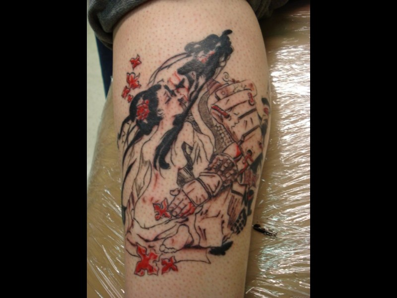 Carelessly painted colored romantic Asian kissing couple tattoo on leg