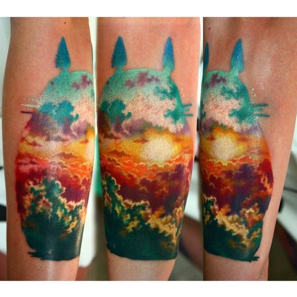 Cartoon hero shaped colored tattoo stylized with beautiful sunrise