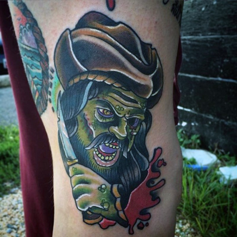 Cartoon like big colored zombie pirate tattoo on thigh