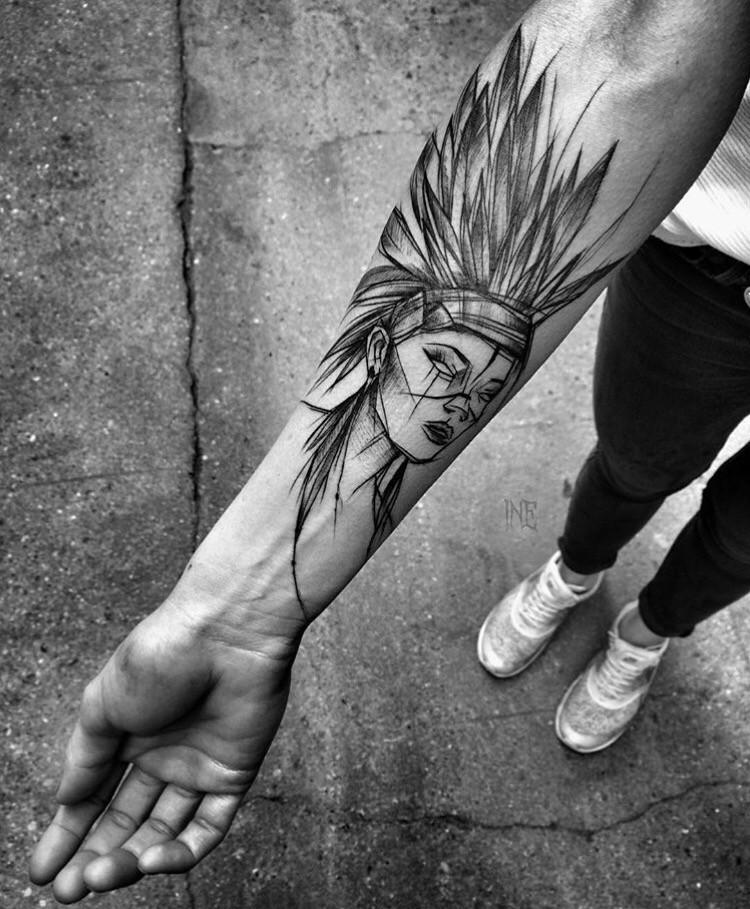 Cartoon like black ink painted by Inez Janiak forearm tattoo of Indian woman