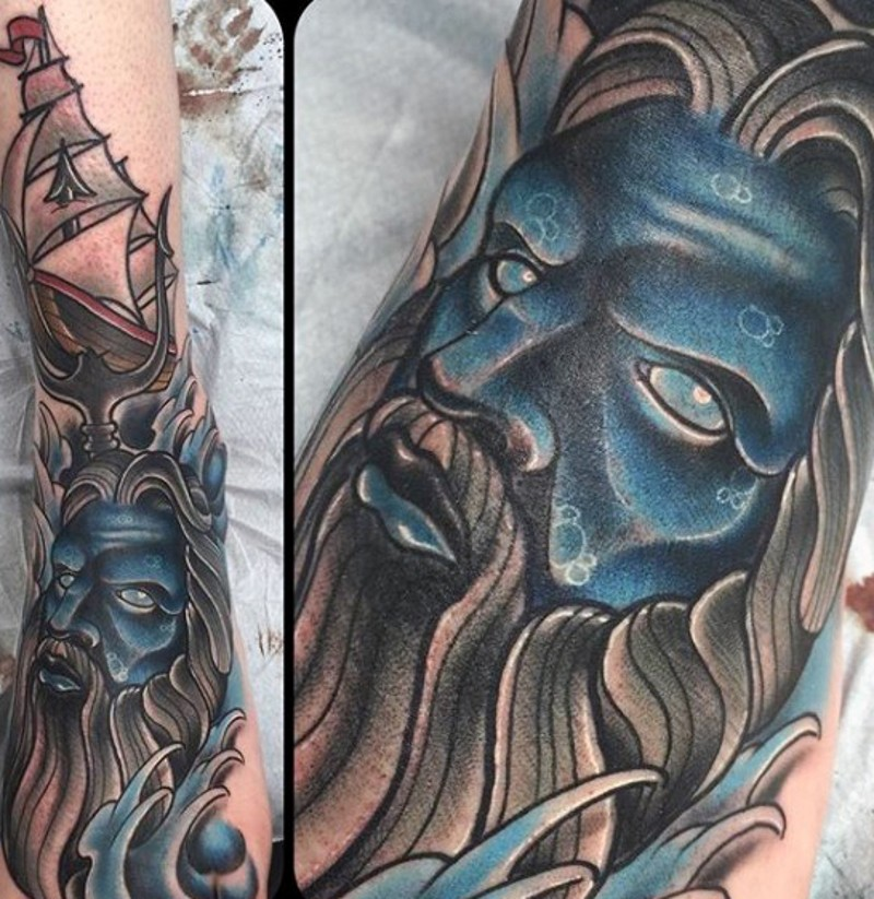 Cartoon like blue colored Poseidon tattoo on sleeve