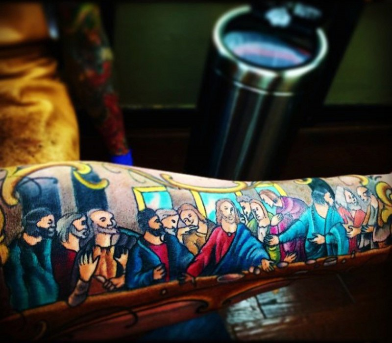Cartoon like colored and designed Lord&quots Supper picture tattoo on sleeve