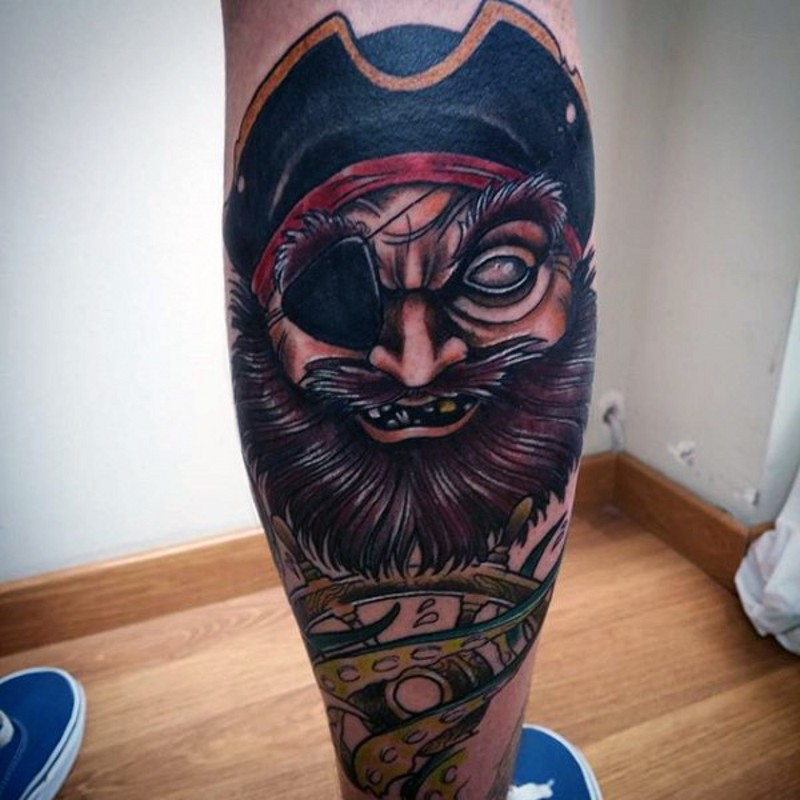 Cartoon like colored funny demonic pirate tattoo on leg