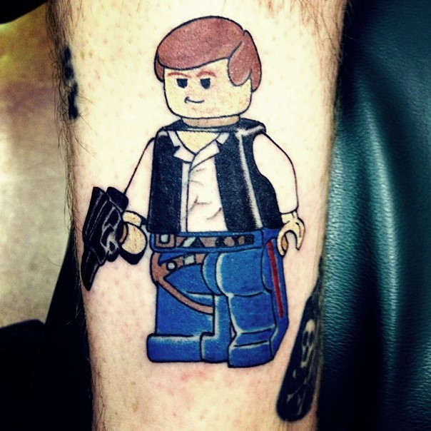 Cartoon like colored funny forearm tattoo of Lego Han Solo