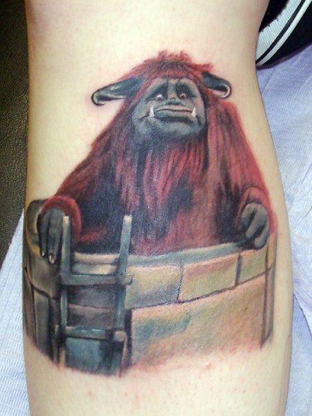 Cartoon like colored funny monster tattoo on leg