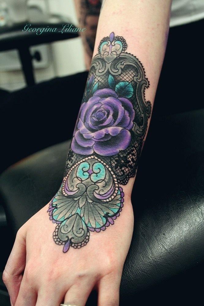 Cartoon like colored nice flower tattoo on wrist