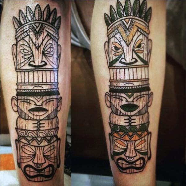 Cartoon like colored tribal statue tattoo on leg