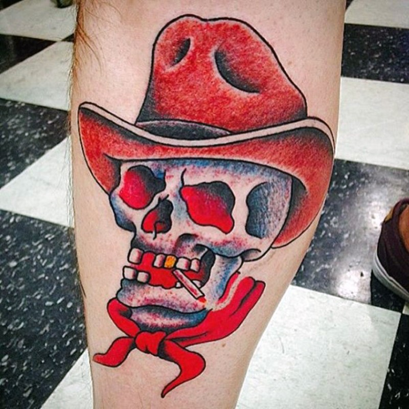Cartoon like colored western cowboy skull with golden tooth and hat tattoo on leg