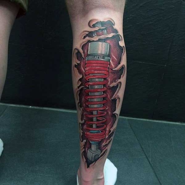 Cartoon like designed and colored biomechanical tattoo on leg