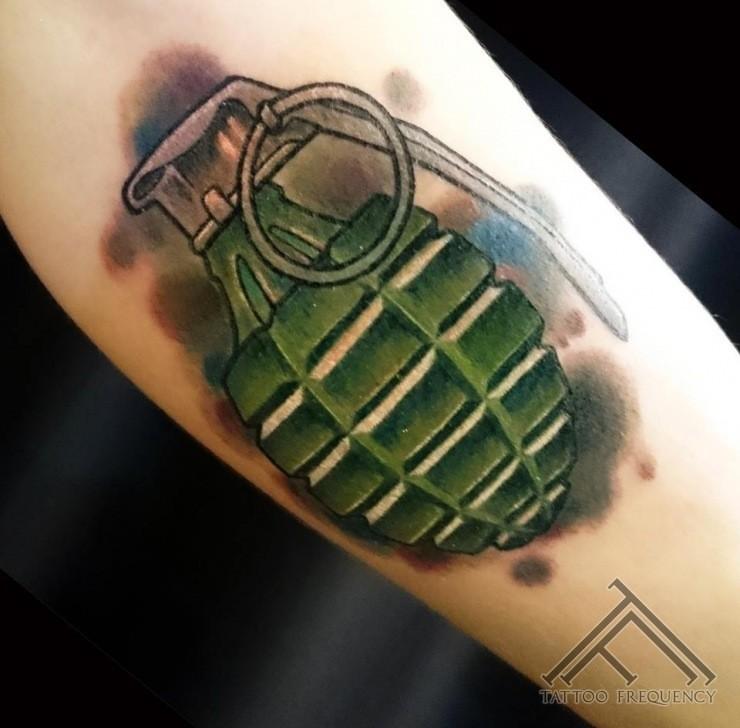 Cartoon like designed nice colored military grenade tattoo on arm