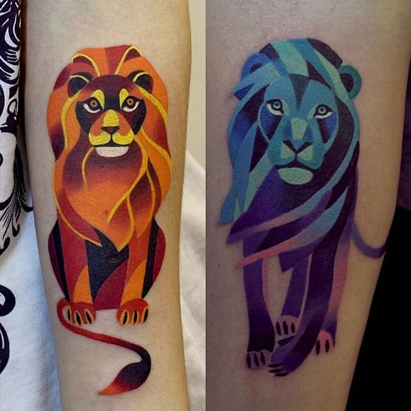 Cartoon like little multicolored lions tattoo on forearm