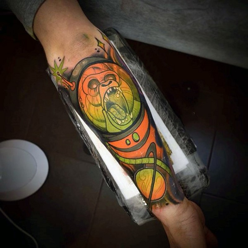 Cartoon like multicolored space monster monkey tattoo on arm