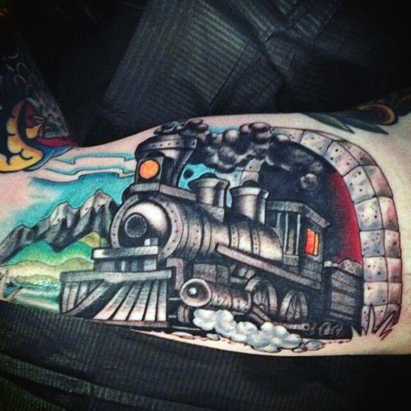 Cartoon like painted and colored old steamy train in tunnel tattoo on arm