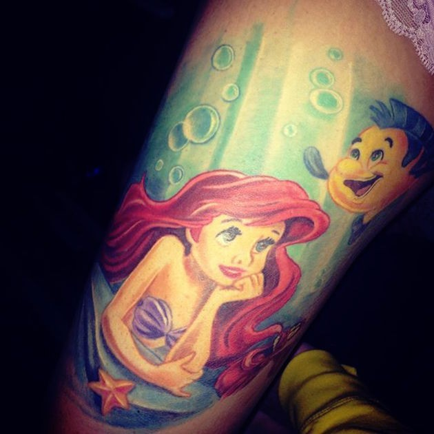 Cartoon mermaid Ariel and Flounder fish at sea bottom multicolored realistic thigh tattoo
