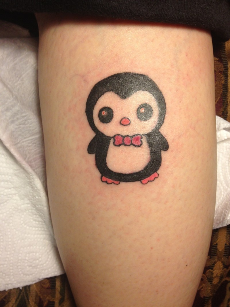 Cartoon penguin tattoo with red bow