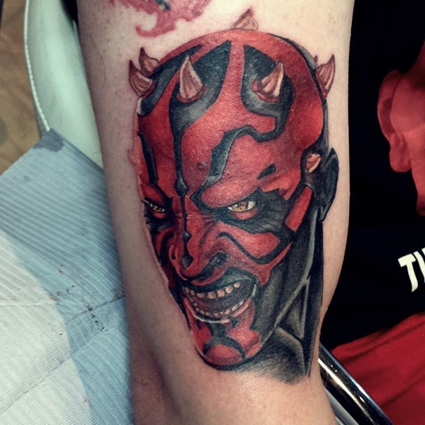 Cartoon style 3D colored evil Darth Maul portrait tattoo on arm