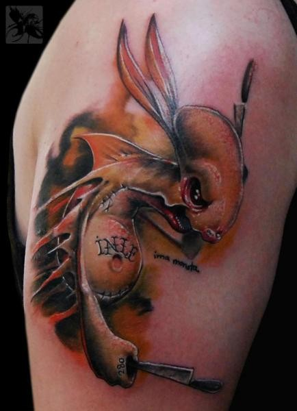 Cartoon style awesome painted and colored shoulder tattoo of creepy creature with knives