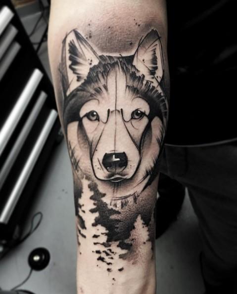 Cartoon style black ink forearm tattoo of big wolf portrait