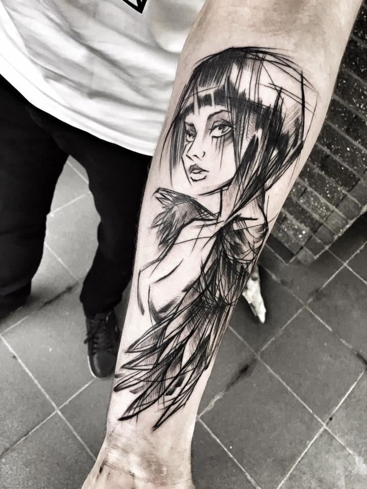 Cartoon style black ink painted by Inez Janiak forearm tattoo of seductive woman