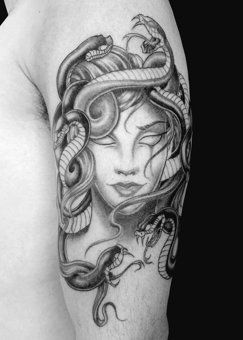 Cartoon style colored 3D style shoulder tattoo of Medusa head