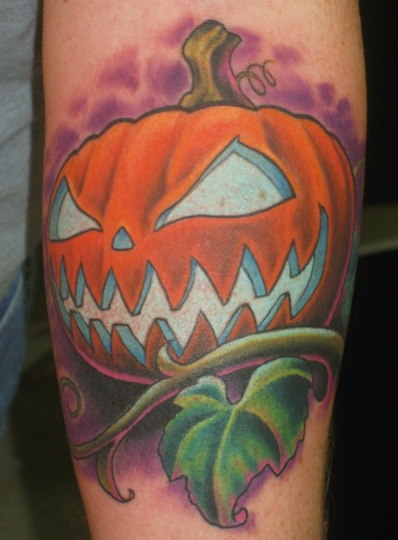 Cartoon style colored arm tattoo of Halloween pumpkin