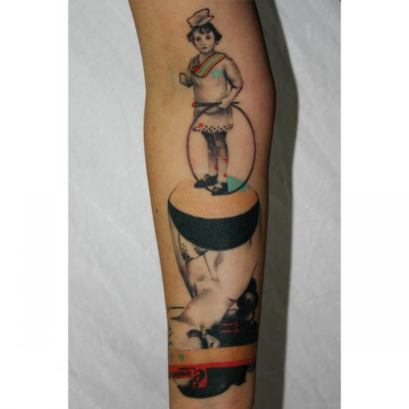 Cartoon style colored arm tattoo of interesting figure