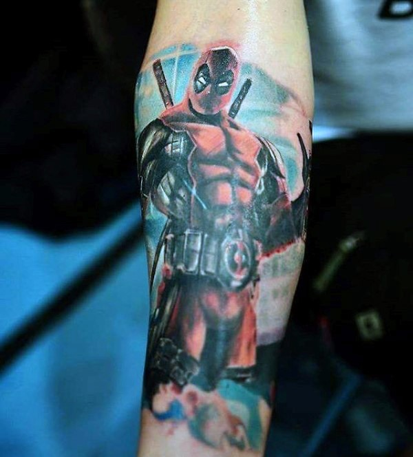 Cartoon style colored arm tattoo of Deadpool with crossed swords