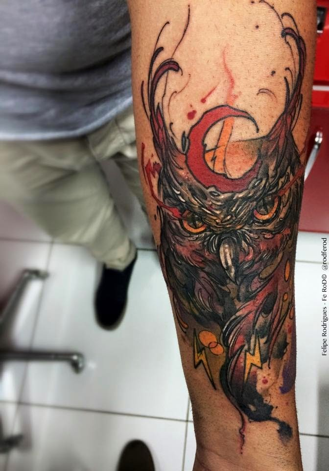 Cartoon style colored arm tattoo of big owl with moon