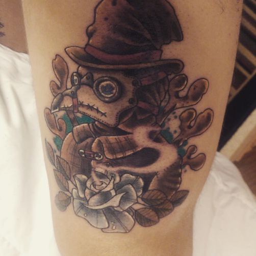 Cartoon style colored arm tattoo of plague doctor with black rose