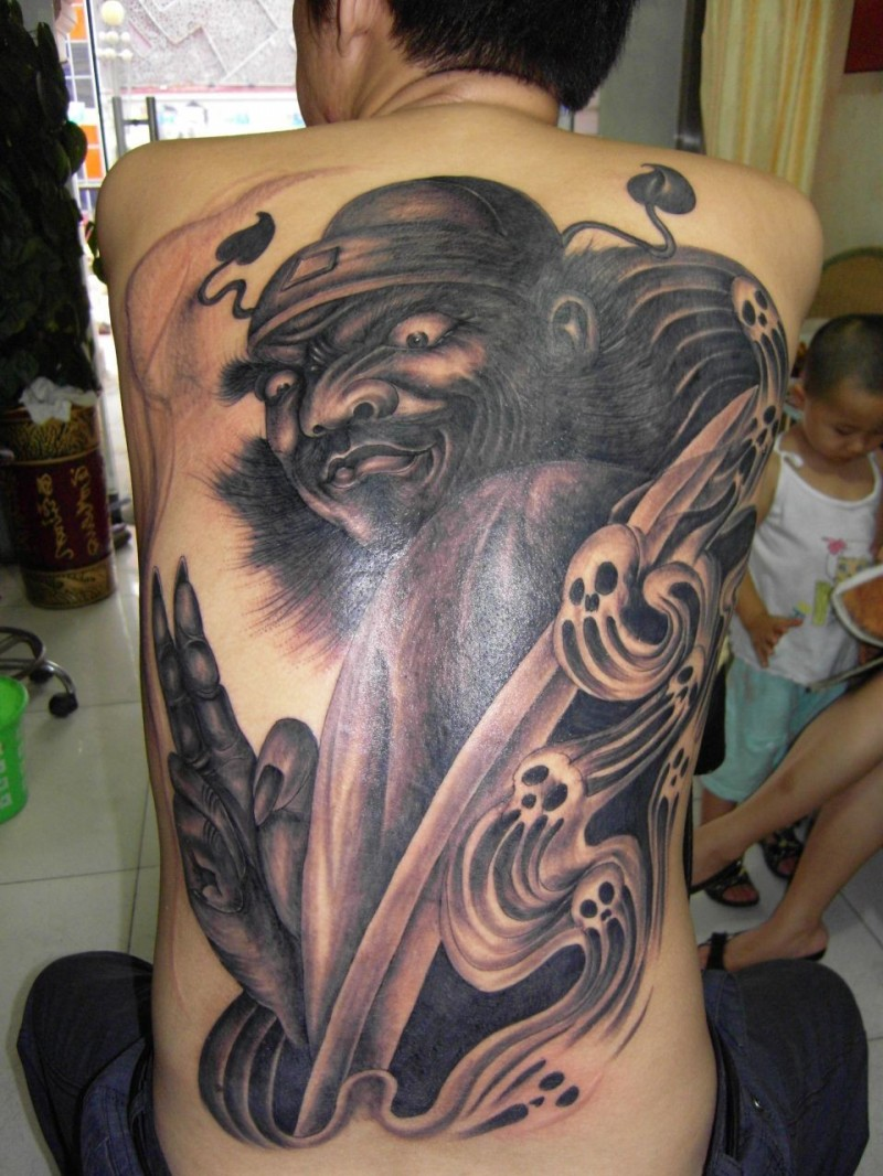 Cartoon style colored back tattoo of mystical warrior with ghost skulls