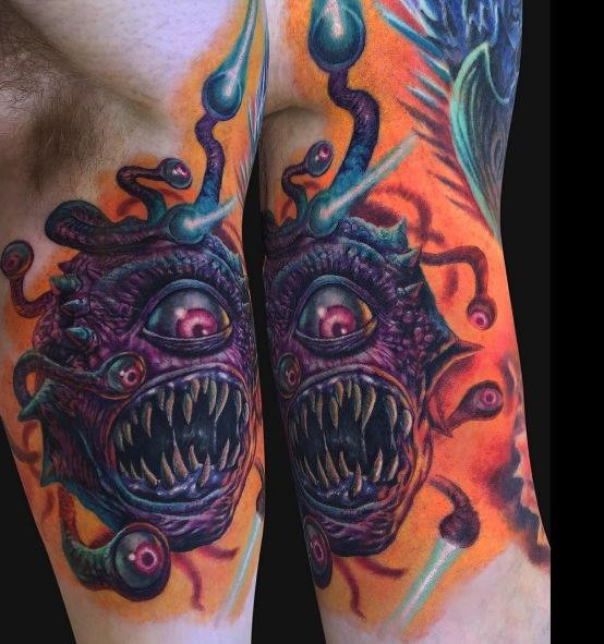 Cartoon style colored biceps tattoo alien monster with eyes